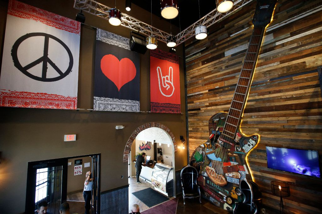 The giant guitar in the entry area of Lava Cantina in The Colony is made with reclaimed items from Hurricane Katrina.