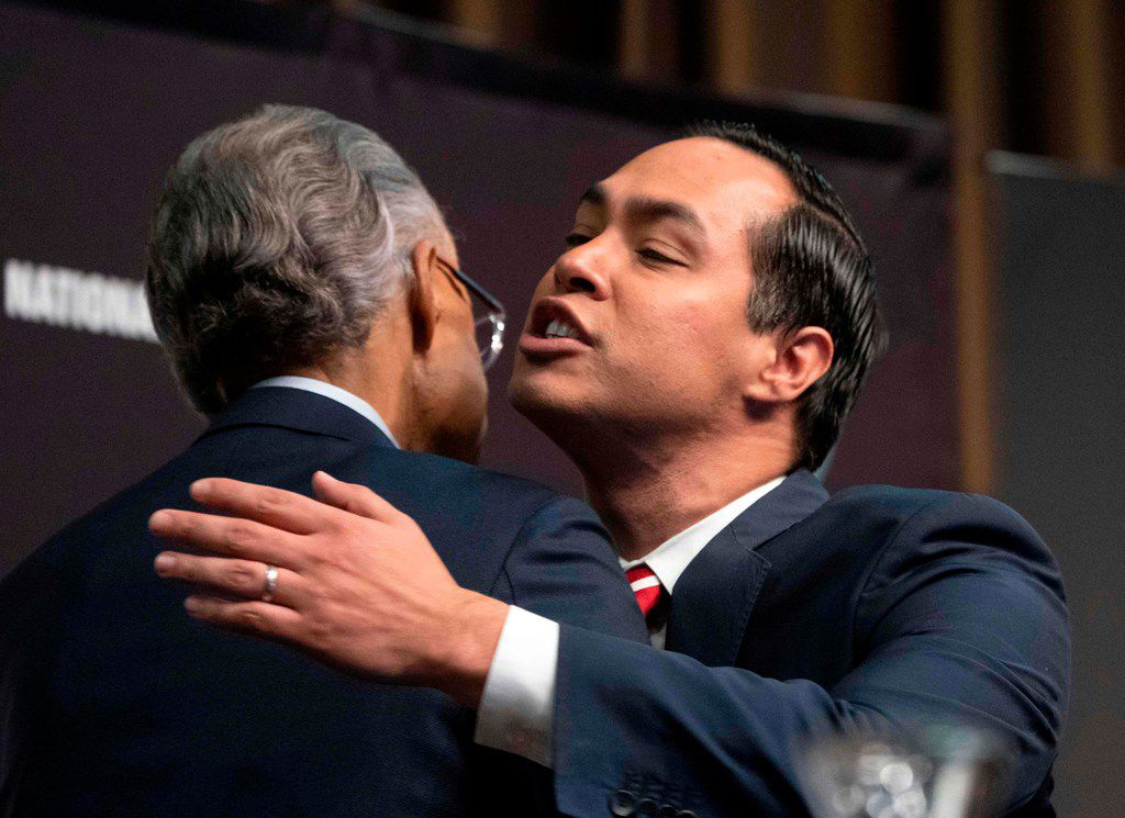 Democratic presidential candidate Julian Castro embraces the Rev. Al Sharpton  during a gathering of the National Action Network in New York City.