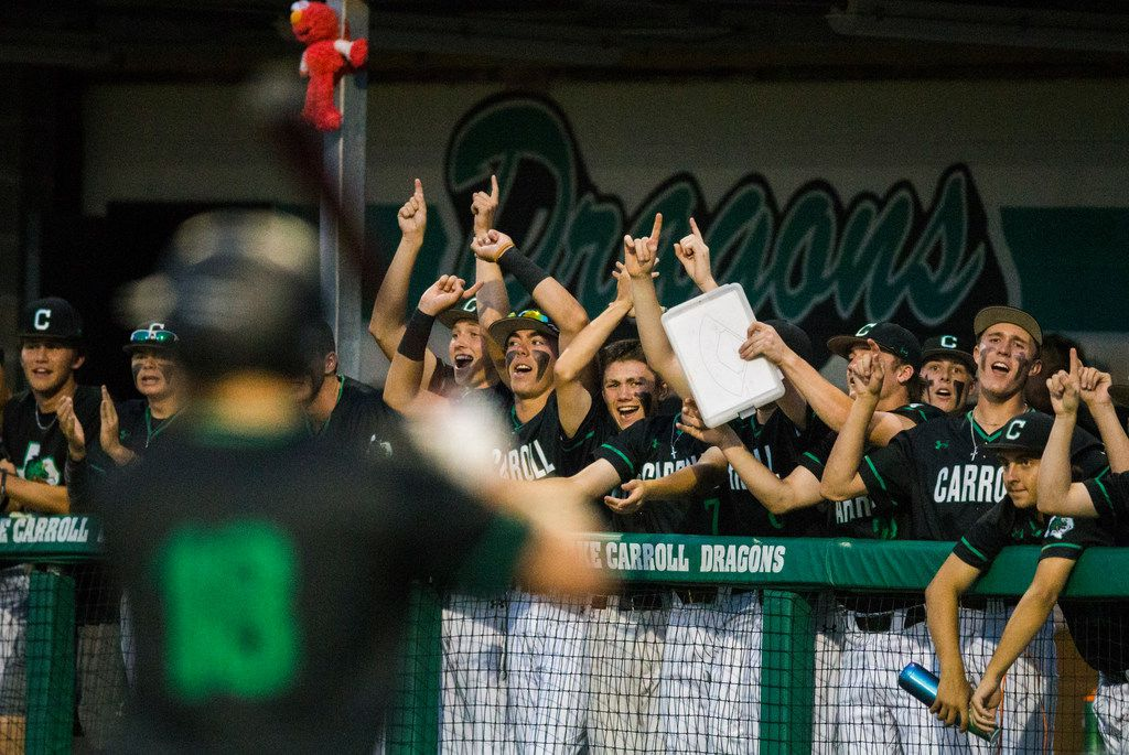 Southlake Carroll players cheer as Grant Golomb (18) steps up to bat during the third inning of Game 2 of a best of 3 Class 6A Region I quarterfinal series between Flower Mound Marcus and Southlake Carroll on Friday, May 17, 2019 at Southlake Carroll Senior High School in Southlake, Texas. (Ashley Landis/The Dallas Morning News)