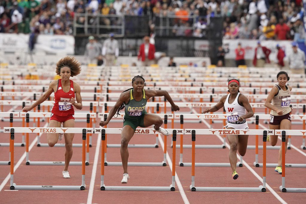 Desoto's Jayla Hollis (1293) takes first place in the girls 6A 100-meter hurdles with a 13.40 clocking at the UIL state track meet in Austin on May 11, 2019. She beat teammate Jalaysi'ya Smith (1299) by .02 seconds.  (Bob Daemmrich/Special Contributor)