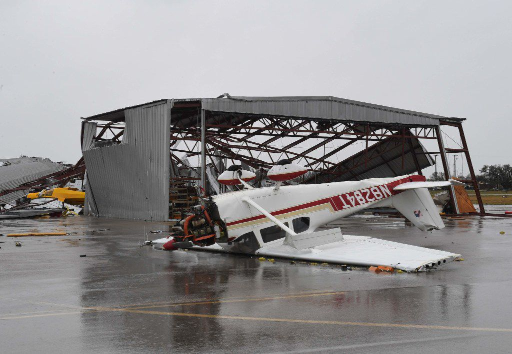 A light plane sits upside done at Rockport Airport after heavy damage when Hurricane Harvey hit Rockport, Texas on August 26, 2017.   Hurricane Harvey slammed into the Texas coast late Friday, unleashing torrents of rain and packing powerful winds, the first major storm to hit the US mainland in 12 years.