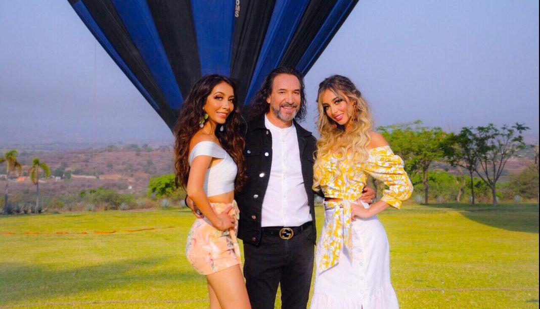 Marco Antonio Solís  junto a sus hijas Alison y Marla en la grabación del video. / Cortesía.