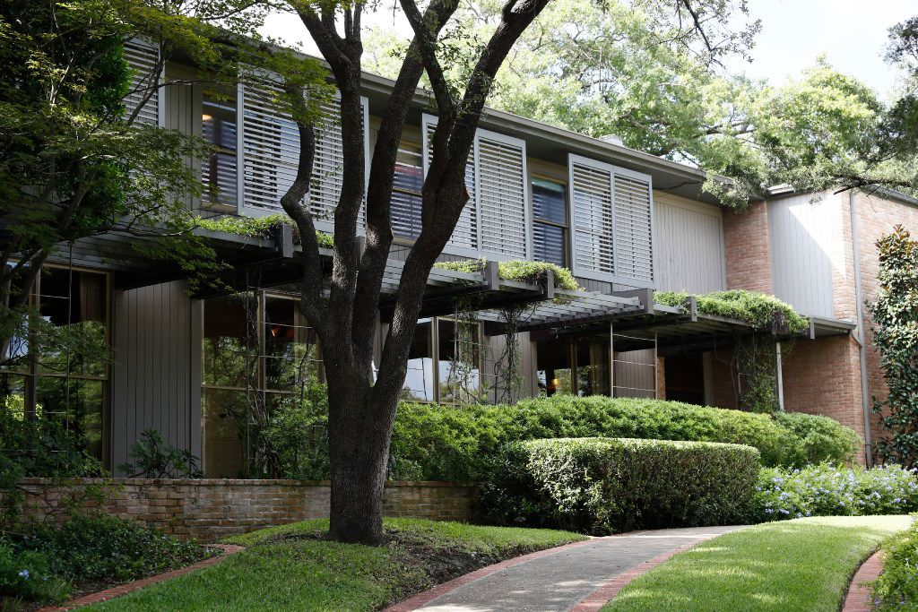With its louvered shutters suspended in air to diffuse sunlight, the Penson house at 3756 Armstrong Ave. is an immaculate work of Texas Modernism by architect O'Neil Ford.