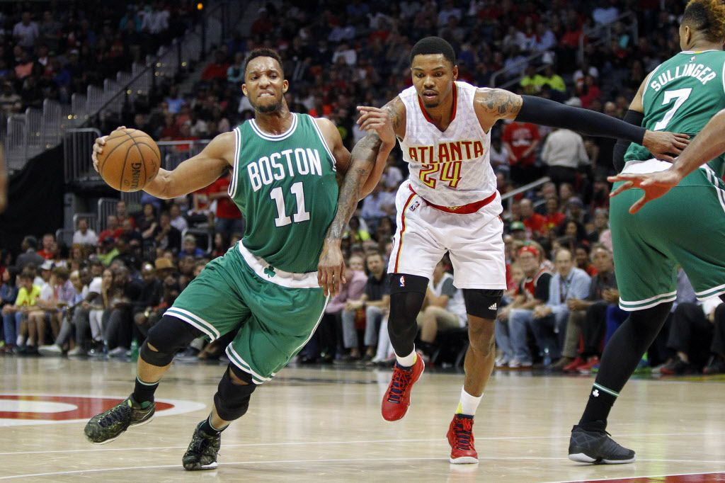Apr 26, 2016; Atlanta, GA, USA; Boston Celtics guard Evan Turner (11) is defended by Atlanta Hawks forward Kent Bazemore (24) in the third quarter in game five of the first round of the NBA Playoffs at Philips Arena. The Hawks defeated the Celtics 110-83. Mandatory Credit: Brett Davis-USA TODAY Sports ORG XMIT: USATSI-268176