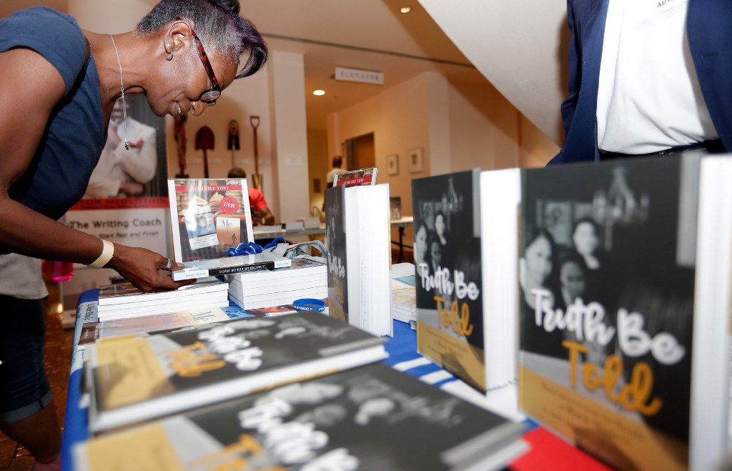 Joya Reed looked over A Matter of Life or Death by Dr. Walter Milton Jr. during the Tulisoma South Dallas Book Fair at the African American Museum in Dallas in August 2017.