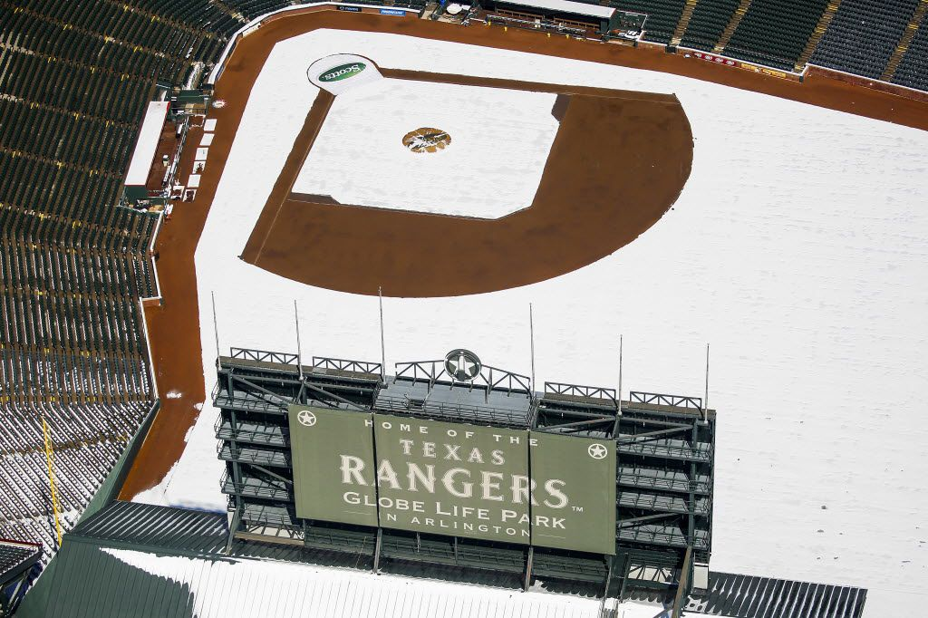 Snow covers the field at Globe Life Park after a record snowfall on Thursday, March 5, 2015, in Arlington. Overnight snow and sleet blanketed the region overnight piling up to 2 to 5 inches across much of the area.  (Smiley N. Pool/The Dallas Morning News)