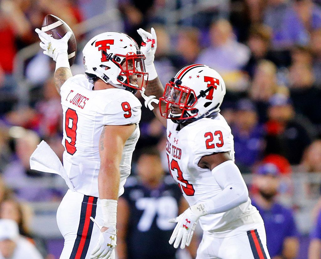 FILE - Texas Tech Red Raiders linebacker Tony Jones (9) recovered a first half fumble against the TCU Horned Frogs at Amon G. Carter Stadium in Fort Worth, Thursday, October 11, 2018. Joining in the celebration is defensive back Damarcus Fields (23). (Tom Fox/The Dallas Morning News)