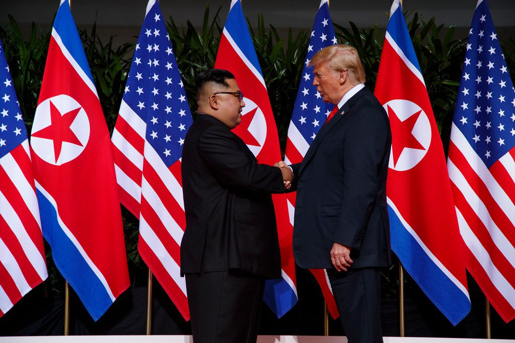 President Donald Trump meets with North Korean leader Kim Jong Un on Sentosa Island, Tuesday, June 12, 2018, in Singapore.