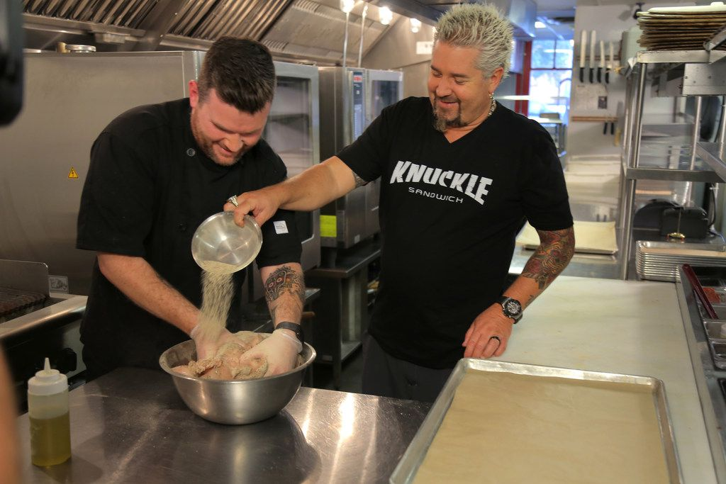 Diners, Drive-Ins and Dives host Guy Fieri cooks with Jeremy Scott, chef and owner of Tutta's Pizza in Dallas. Tutta's was featured on the show in early January 2018.