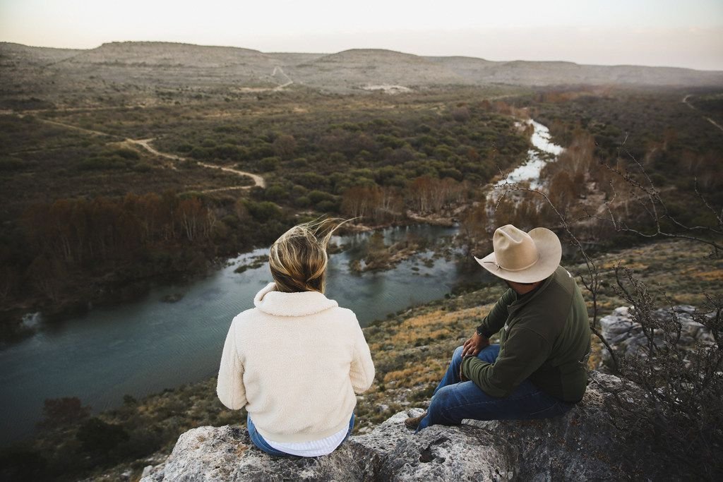 Hikers enjoy a scenic overlook at Hudspeth River Ranch near Comstock, Texas, one of eight ranches offered by Exploreranches.com.