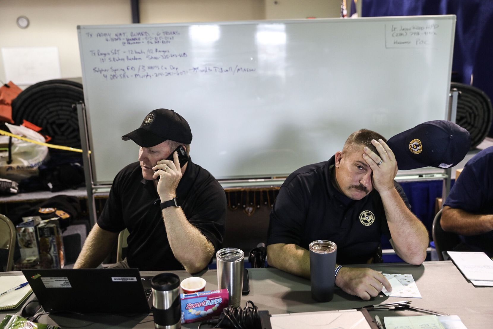 From left, Mark Koenig, a lieutenant with the Texas Department of Public Safety, and Chad Shaw, a deputy chief with the Harris County Fire Department, coordinate rescue operations in Houston on Wednesday, Aug. 30, 2017. With floodwaters still rising in some parts of the Houston area on Wednesday, officials cautioned that they still had no way to gauge the scale of the catastrophe -- how many were dead, how many were taking shelter inland or still hunkered down, or how many homes were destroyed.