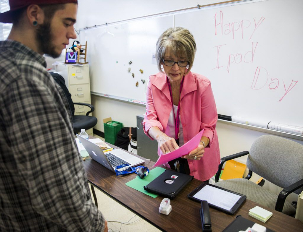Dillan Akin works with campus technology specialist Vickie Dugan at Garland High School. As part of the $25 million program approved by voters in the district's 2014 bond election, each campus has an assigned specialist to work with students and staff.