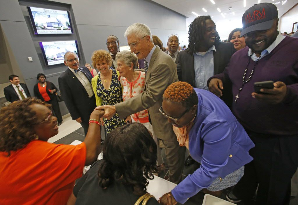 Area resident Dianne Gibson, left,  greets J. McDonald Williams, founder of the Frazier Revitalization, Inc., after the ceremonies celebrating the dedication of the new Hatcher Station Health Center, Parkland's newest community clinic, on Thursday, May 7, 2015.