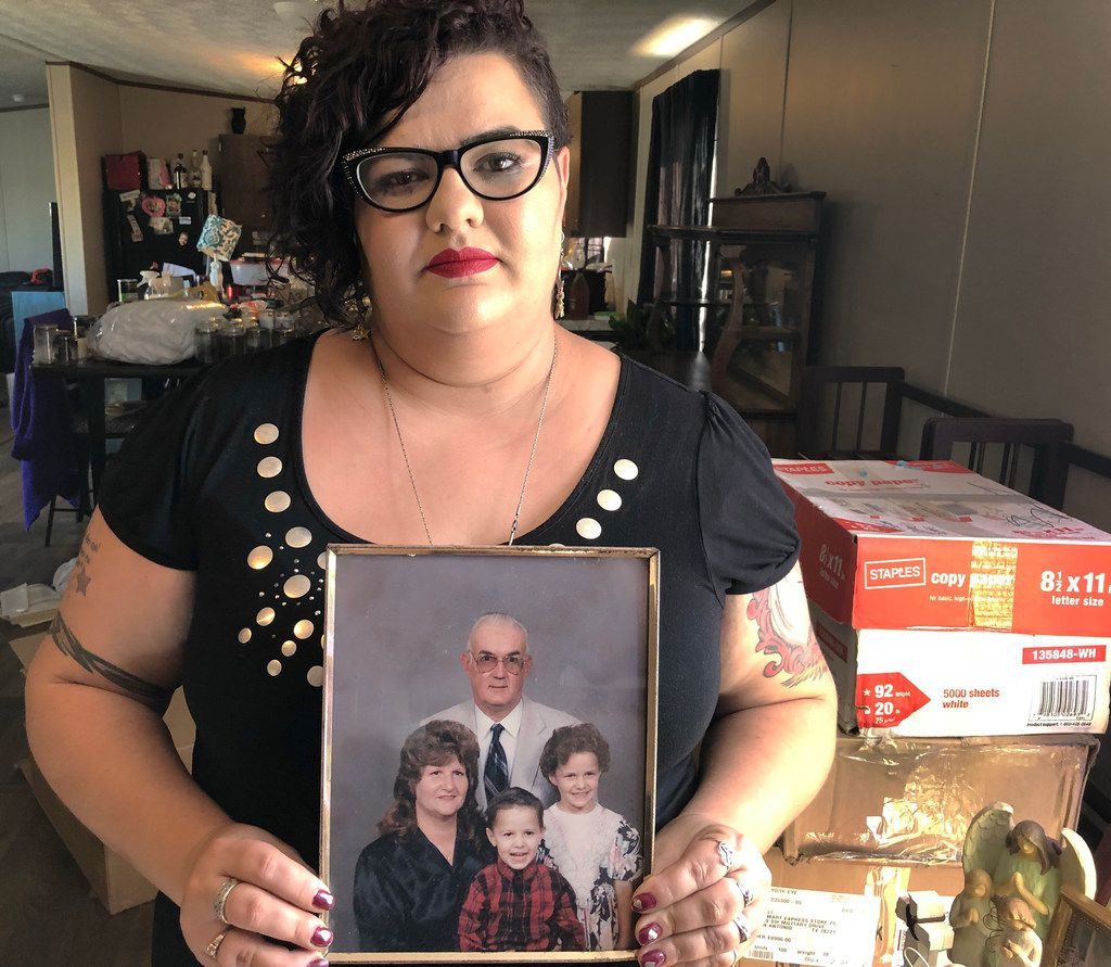 Kati Wall, who lost her parents Dennis and Sara Johnson in the Sutherland Springs church shooting, holds a photo of her family at her home in Floresville, Texas on Friday, November 2, 2018. She and her family are packing to move away from the scene of the tragedy.  November 5 is the one-year anniversary of the attack at Sutherland Springs Baptist Church, where 26 people were killed by a lone gunman at a Sunday morning worship service.
