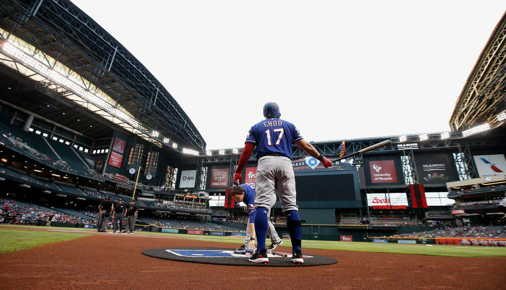 Texas Rangers' Shin-Soo Choo, of South Korea, waits to bat in the first inning of the team's baseball game against the Arizona Diamondbacks on Tuesday, April 9, 2019, in Phoenix. (AP Photo/Ross D. Franklin)