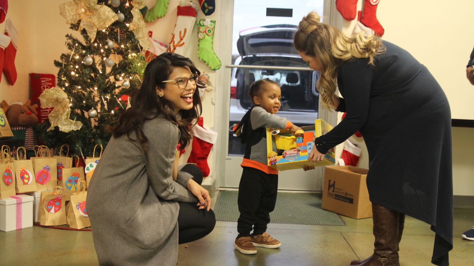 City Credit Union hosted a toy drive to benefit Buckner International. Here, employees deliver toys to Buckner's Humanitarian Center in Mesquite. (Photo from City Credit Union..