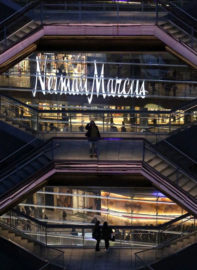 The Neiman Marcus store sign is visible as people gather inside The Vessel, at the opening of Hudson Yards in Manhattan, New York in March.