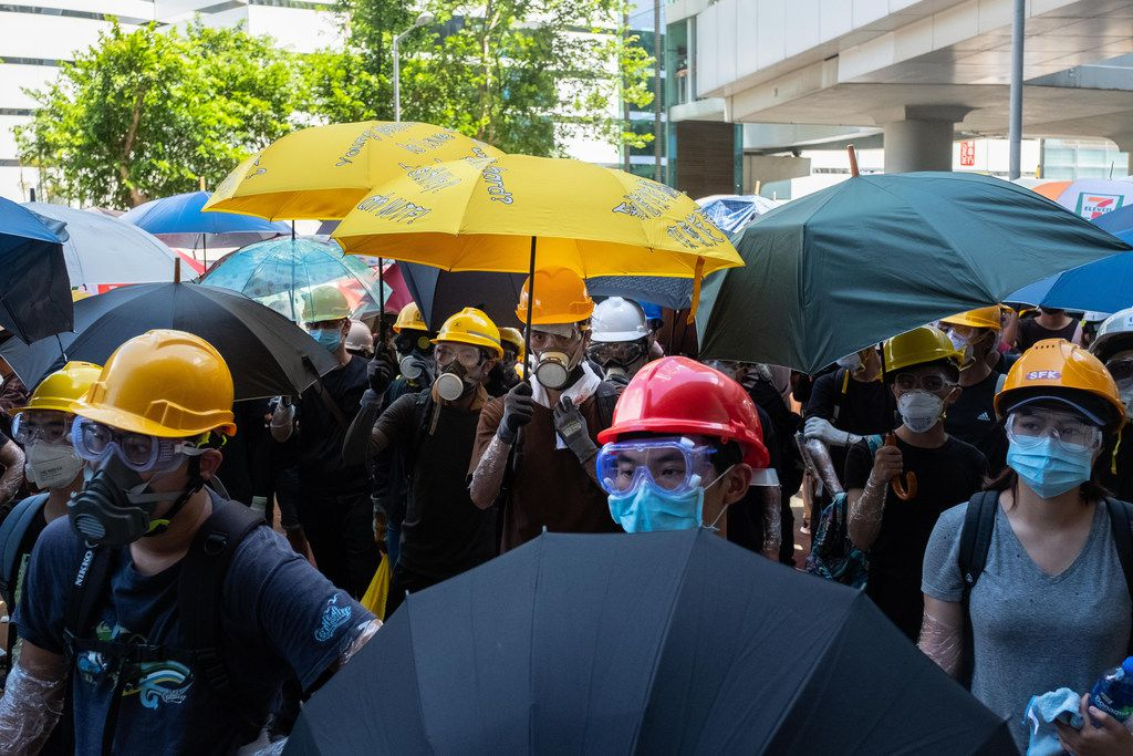 JULY 01: Protesters gather outside Legislative Council Complex protest against the extradition bill on July 1, 2019 in Hong Kong. Thousands of pro-democracy protesters faced off with riot police during the 22nd anniversary of Hong Kong's return to Chinese rule as riot police officers used batons and pepper spray to push back demonstrators. The city's embattled leader Carrie Lam watched a flag-raising ceremony on a video display from inside a convention center, citing bad weather, as water-filled barricades were set up around the center. (Billy H.C. Kwok/Getty Images)
