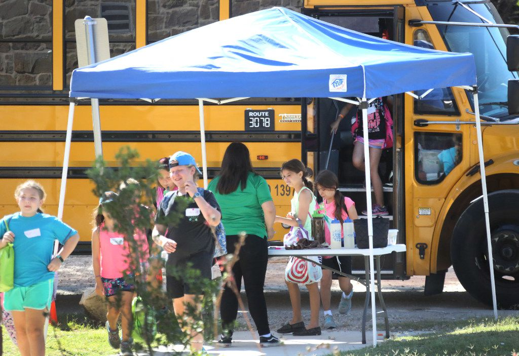 Young Girl Scout campers arrive at summer camp at Camp Whispering Cedars in Dallas.