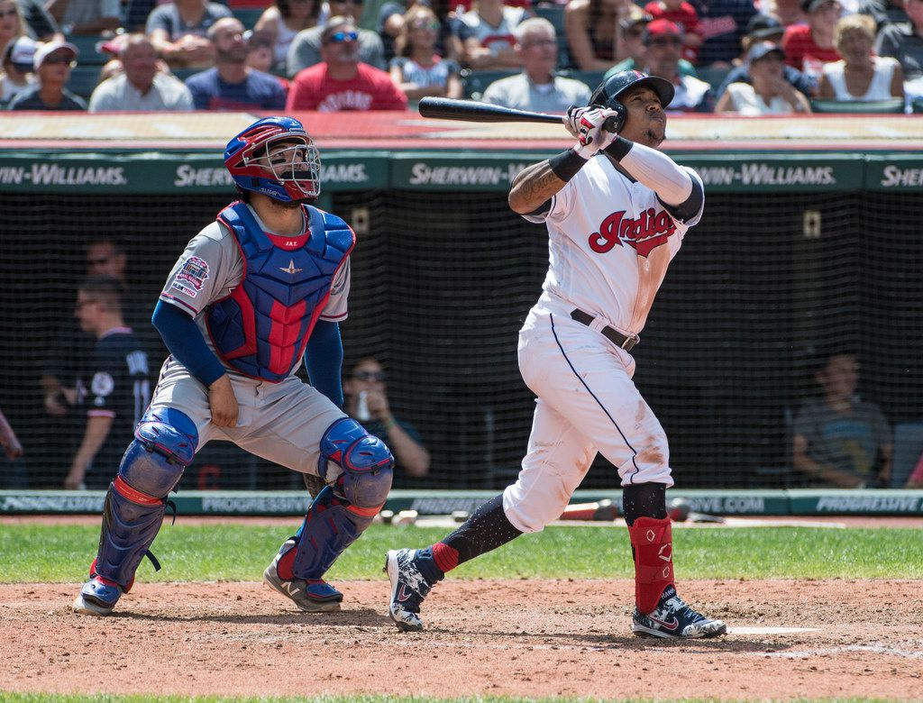 Cleveland Indians' Jose Ramirez watches his two-run home run off Texas Rangers starting pitcher Ariel Jurado with Rangers catcher Jose Trevino during the seventh inning of the first game of a baseball doubleheader in Cleveland, Wednesday, Aug. 7, 2019. (AP Photo/Phil Long)