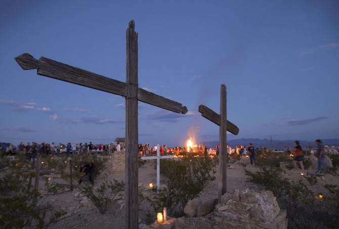 As the sun sets on the Terlingua Ghost Town graveyard residents gather around the bonfire to eat a community dinner, remember loved ones and listen to music provided by local musicians.