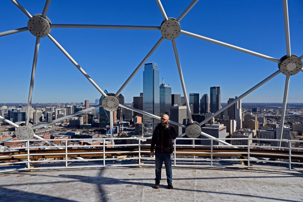 Matt Peterson, 45, creative director with Melrose Pyrotechnics, makes a phone call while standing on the roof of the Five Sixty by Wolfgang Puck as his team prepares to install New Years Eve fireworks at Reunion Tower in Downtown Dallas, Dec. 27, 2018. The Chicago based company has been working the New Years Eve show for the past five years.