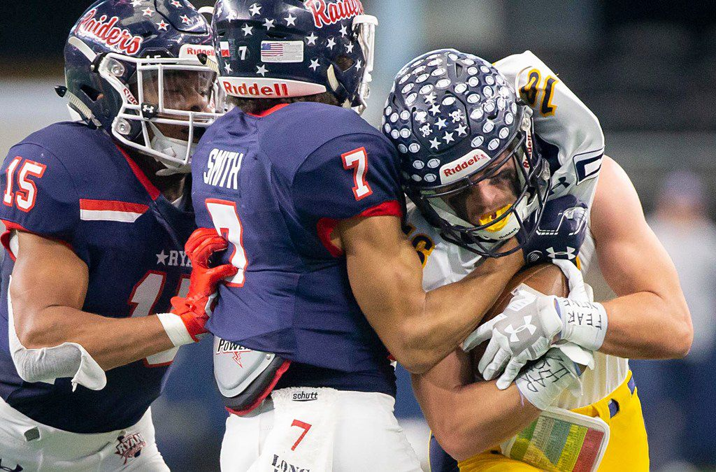 Highland Park wide receiver Finn Corwin (16) is wrapped up by Denton Ryan's Tra Smith (7) and Aaron Dixon (15) during the first half of a Class 5A Division I state semifinal state semifinal at AT&T Stadium on Saturday, Dec. 15, 2018, in Arlington. (Smiley N. Pool/The Dallas Morning News)
