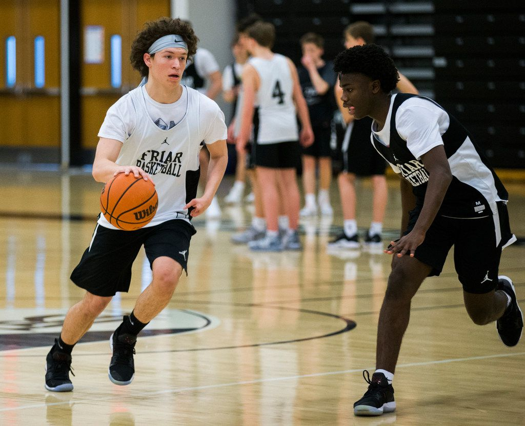 Bishop Lynch High School varsity basketball player Jarett Nunez, left, makes his way down the court during practice on Thursday, January 24, 2019 at Bishop Lynch High School in Dallas. Nunez was born with a deformed left hand, but that didn't stop him from making the varsity basketball team, running track or playing football. (Ashley Landis/The Dallas Morning News)