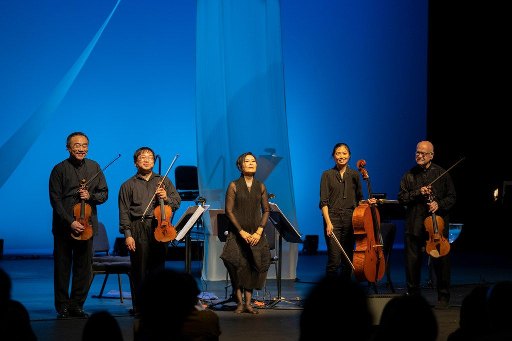 Performers in Chamber Music International's presentation of Tan Dun's Ghost Opera, from left, Cho-Liang Lin and Michael Shih (violins), Min Xiao-Fen (pipa), Sophie Shao (cello) and Atar Arad (viola).