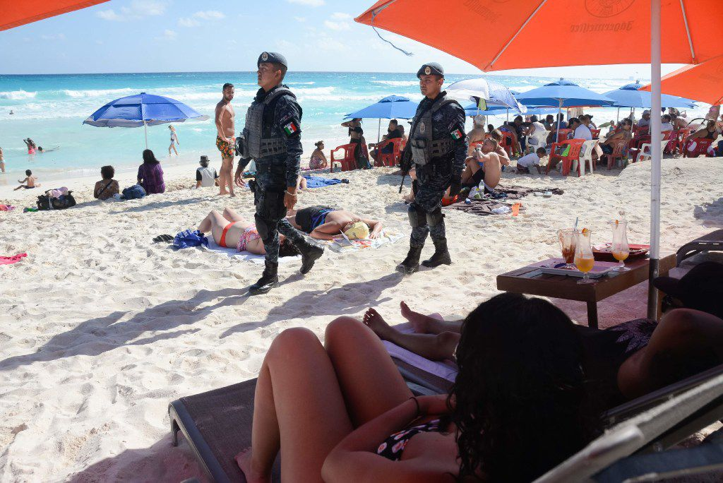 (FILES) This file photo taken on January 18, 2017 shows Mexican Federal Police patrolling a beach in Cancun, Mexico, where a shooting occurred in a nightclub the day before. The US State Department on August 22, 2017, issued a travel advisory warning US citizens of travel to Cancun and Los Cabos due to increased violence.     / AFP PHOTO / STRSTR/AFP/Getty Images