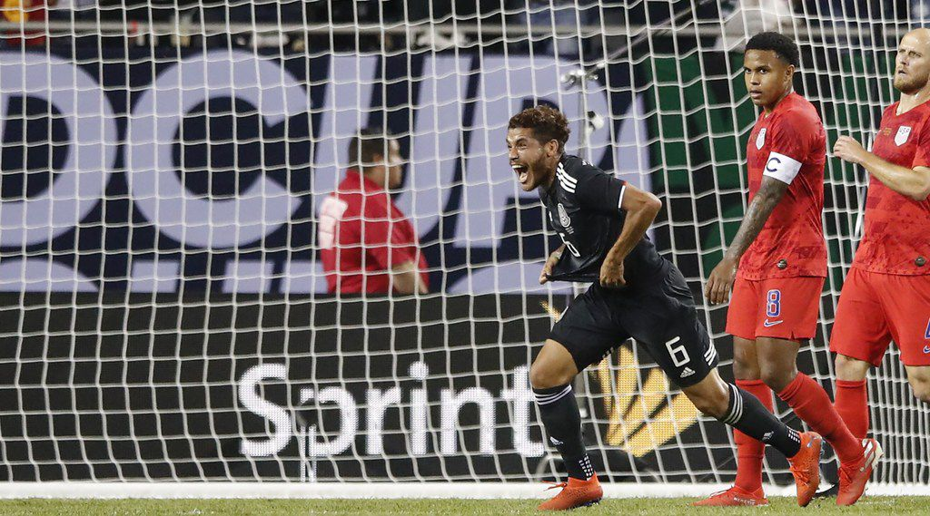 Mexico's midfielder Jonathan dos Santos (C) celebrates after scoring against the United States during the second half of 2019 Concacaf Gold Cup final football match between USA and Mexico on July 7, 2019 at Soldier Field stadium in Chicago, Illinois. (Photo by KAMIL KRZACZYNSKI / AFP) / ALTERNATIVE CROPKAMIL KRZACZYNSKI/AFP/Getty Images