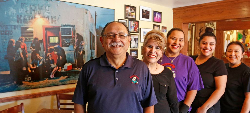 The family at Herrera's Cafe at 3311 Sylvan Avenue in Dallas, with an enlarged vintage photograph of the restaurant from the 1970s in the background. Left to right are Larry Ontiveros (grandson), Nora Ontiveros (granddaughter), DeeAnn Ontiveros (great granddaughter), Brittany Olivarez (great great granddaughter), and Melisa Rivas (great grand daughter),  photographed on September 19, 2018.