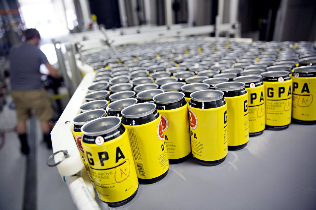 Empty cans are lined on a machine used to can beer at 3 Nations Brewing Friday, October 16, 2015 in Farmers Branch, Texas. The brewery has been in operation for about four months, and currently produces three different kinds of beer.