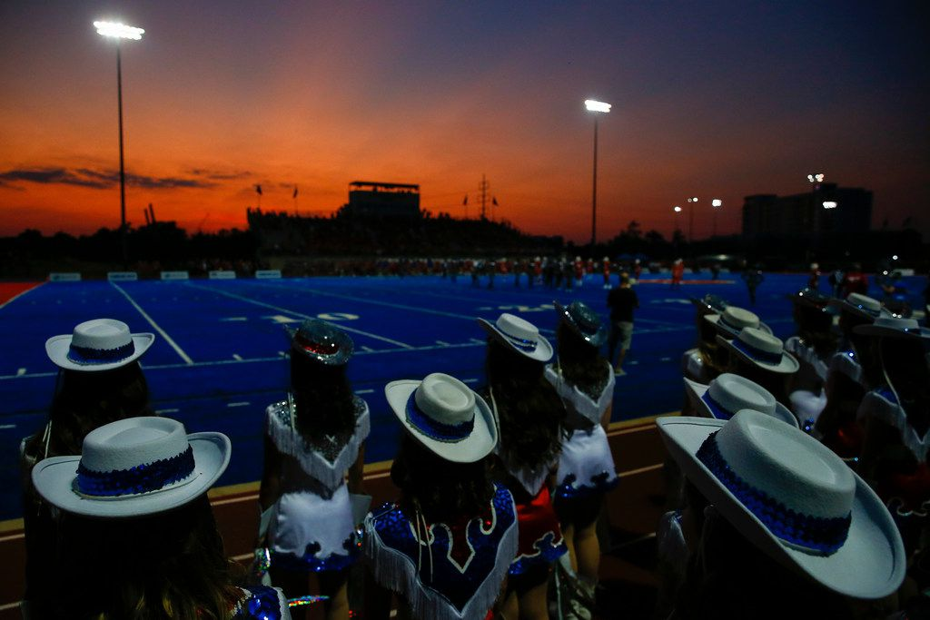 The sun sets over a high school football game between Parish Episcopal and Trinity Christian-Cedar Hill on Thursday, Sept. 5, 2019 in Dallas. (Ryan Michalesko/The Dallas Morning News)