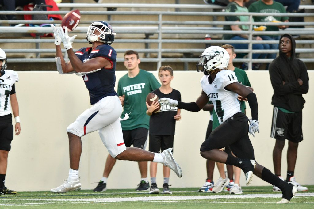 Ryan wide receiver Ja'Tavion Sanders (1) catches a pass from Ryan quarterback Seth Henigan (17), while Poteet defensive back Jahmad Jackson (14) chases after him at C.H. Collins Athletic Complex, Friday, August 30, 2019, in Denton, Texas.