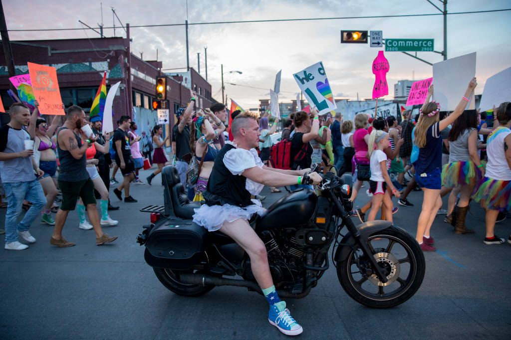 Damon Carver, of Fort Worth rides on his motorcycle during the Queer Bomb Dallas procession march though in Deep Ellum streets on June 25, 2016 in Dallas. (Ting Shen/The Dallas Morning News)