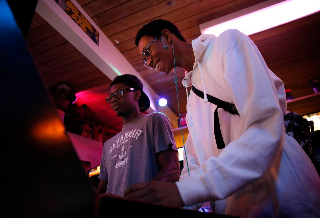 Colby Hurd (right) and Michael Newton play Mortal Kombat at Quarter Lounge Arcade in Bedford.