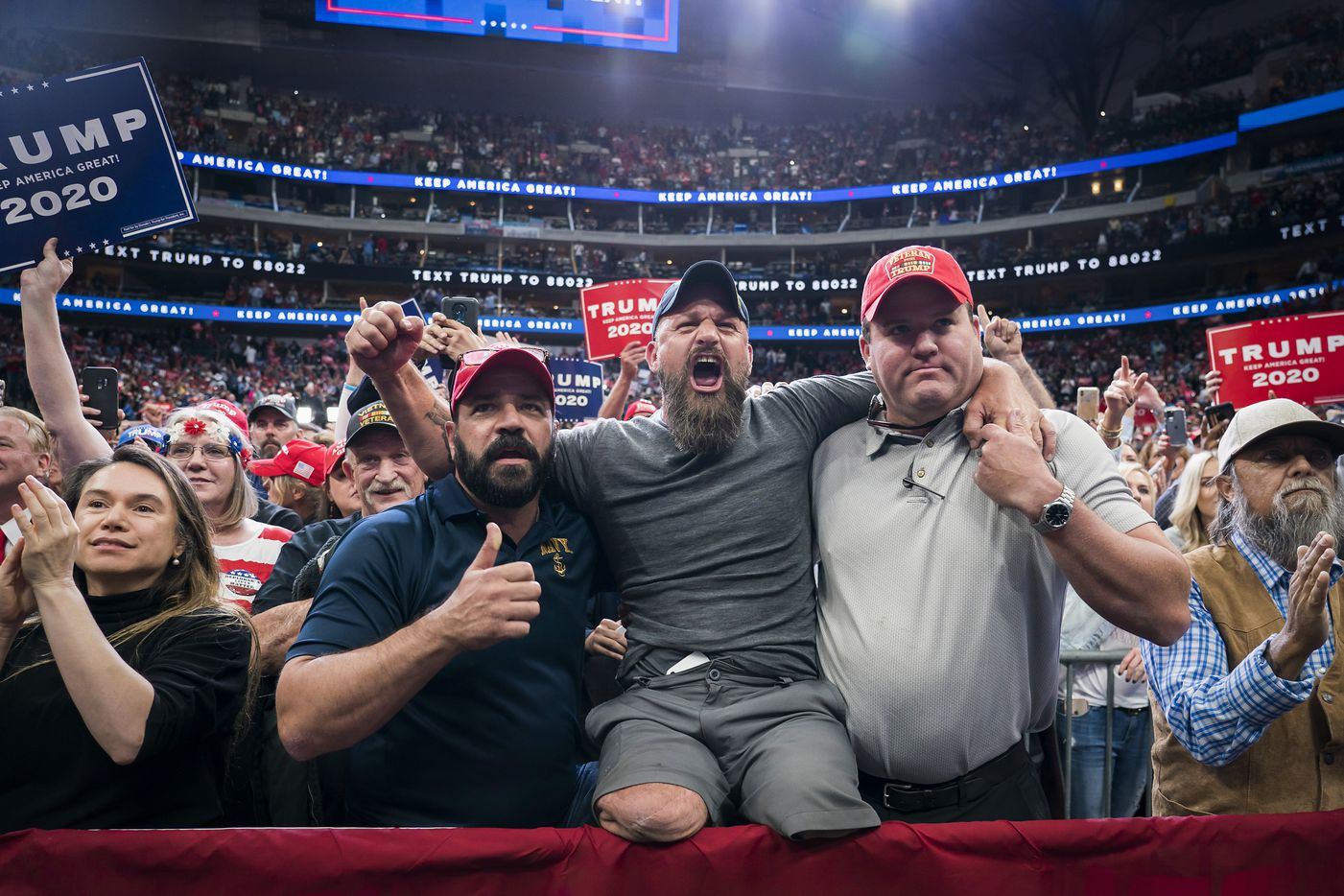 Wheeler, who told the Associated Press that he lost his legs after a training injury when jumping out of a Blackhawk helicopter stateside in 2002, joined other supporters in the front form as President Donald Trump speaks during a campaign rally at the American Airlines Center on Thursday, Oct. 17, 2019, in Dallas.
