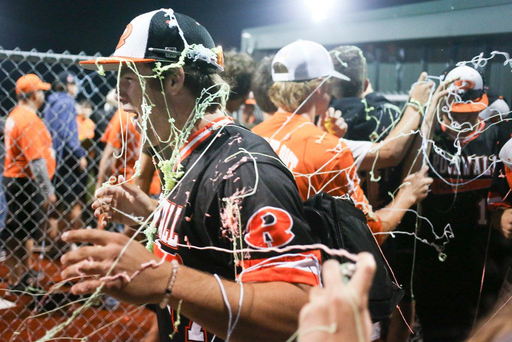 Rockwall's Paden Adams (7) gets spayed with confetti following the team's 11-1 victory over Prosper in a Class 6A Region II baseball quarterfinal series at Wylie High School baseball fields in Wylie, Texas on Saturday, May 18, 2019. (Shaban Athuman/Staff Photographer)