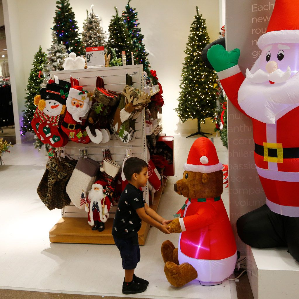Raul Trejo plays with a blow up bear in the holiday section of J. C. Penney at Collin Creek Mall in Plano, Texas on Sept. 26, 2017.