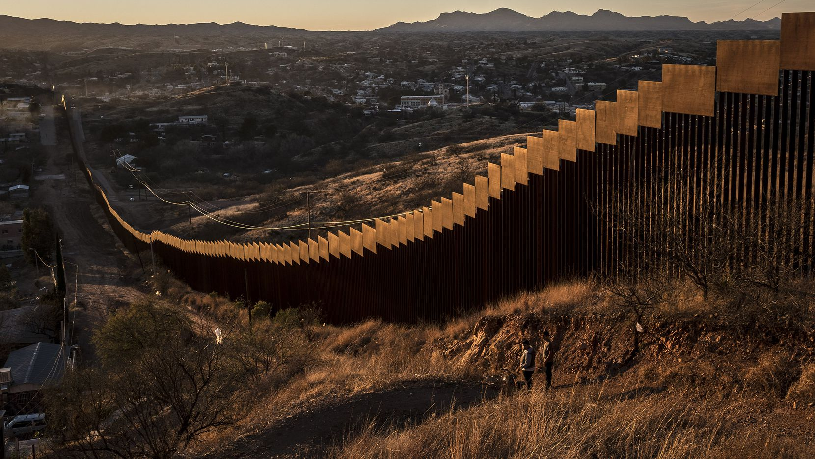 The border wall, here made of tall steel beams in rows, in Nogales. Mexico, Jan. 30, 2017. The current version is new enough that teenagers who grew up here still remember its construction. (Bryan Denton/The New York Times)