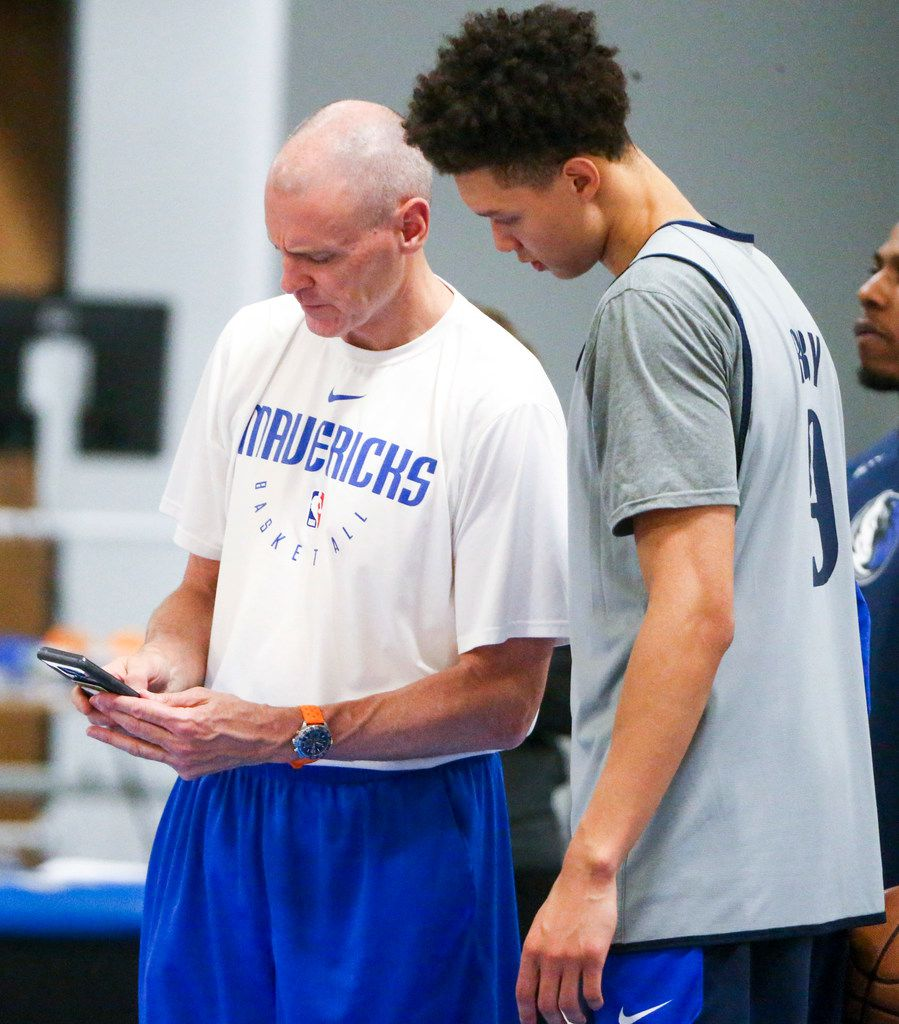 Mavericks coach Rick Carlisle shows Isaiah Roby (9) a video during a summer League practice at the team's practice facility in Dallas on Wednesday, July 3, 2019. (Shaban Athuman/Staff Photographer)