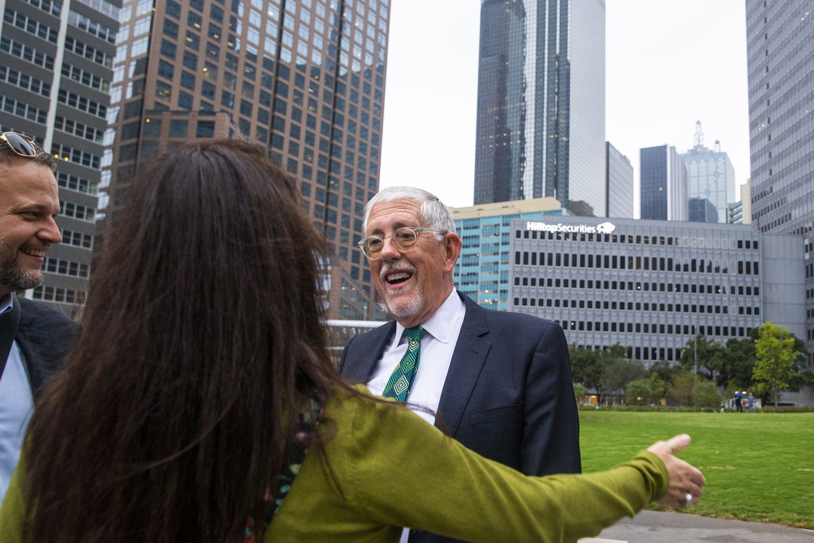 Well-wishers congratulate retiring Dallas Park and Recreation director Willis Winters following the opening ceremony for Pacific Plaza in downtown Dallas on Monday, Oct. 14, 2019. The plaza is the first of four new green spaces that will open by the end of 2022 with help from the nonprofit Parks for Downtown Dallas. (Lynda M. Gonzalez/The Dallas Morning News)