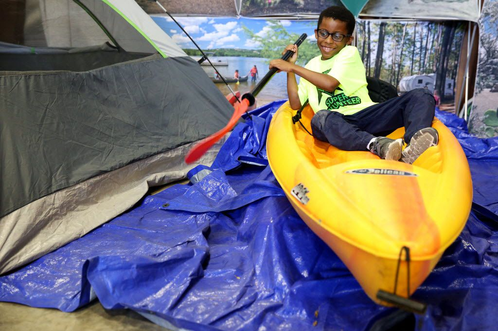 Evan Williams, 7, of McKinney, Texas, pretends to row a kayak during Earth Day Texas at Fair Park in Dallas Saturday April 23, 2016. The event had 771 environmental nonprofit groups, government agencies, business and academic institutions. The three-day event includes speakers, student field trips, and the E Day conference. (Andy Jacobsohn/The Dallas Morning News)