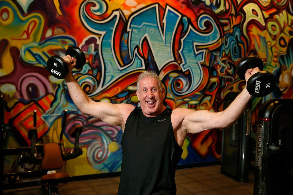 Larry North, in front of a graffiti wall at his new gym in Preston Center, hopes to attract a younger generation his not-your-mother's gym  (Nathan Hunsinger/The Dallas Morning News)