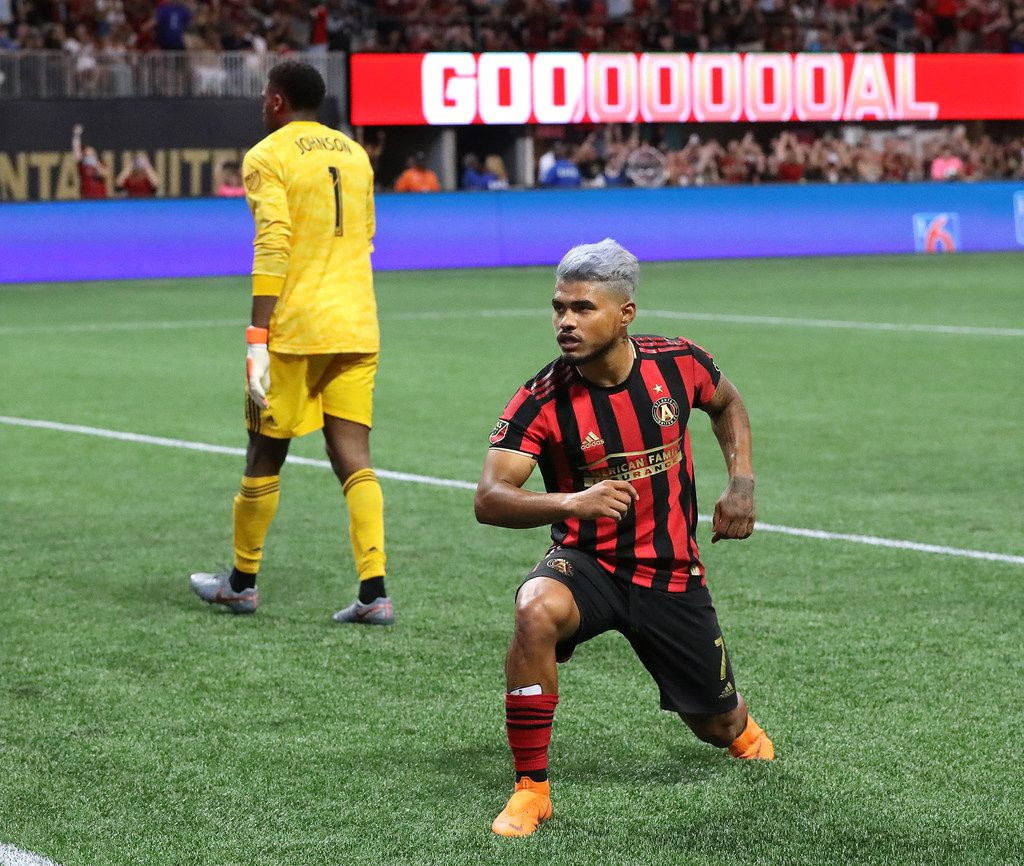 Atlanta United forward Josef Martinez strikes a victory pose for the fans after making a penalty kick for his second goal against New York City FC goalkeeper Sean Johnson (left) during a 2-1 victory on Sunday, Aug. 11, 2019, in Atlanta, Ga. (Curtis Compton/Atlanta Journal-Constitution/TNS)