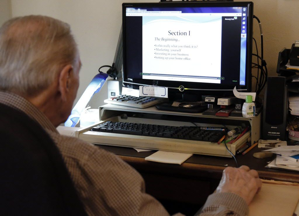 File photo of Arno Zwillenberg, 91, doing online training at his personal computer at his home in Dallas to become a notary public.