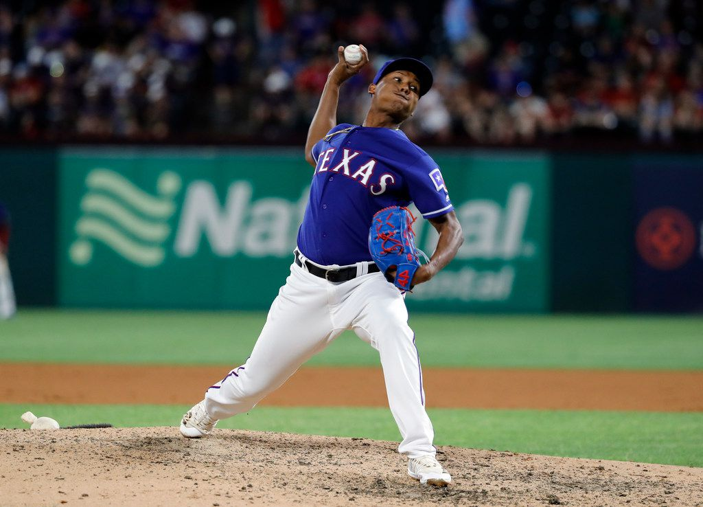 Texas Rangers relief pitcher Jose Leclerc throws to the Seattle Mariners in the eighth inning of a baseball game in Arlington, Texas, Tuesday, May 21, 2019. (AP Photo/Tony Gutierrez)
