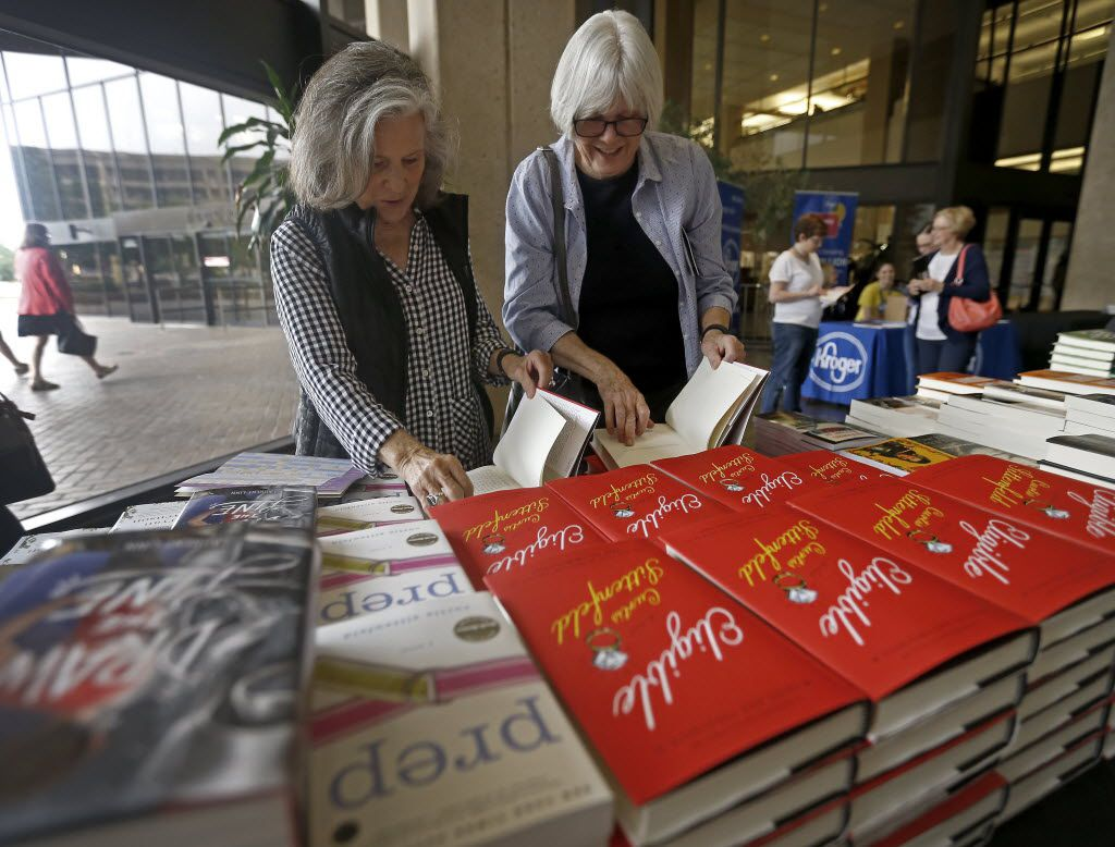 Joyce Dorsey (left) and her friend Jen Carrick take a look at books at the the Wild Detectives Bookstore table during Dallas Book Festival at J. Erik Jonsson Central Library in Dallas, Saturday, April 30, 2016. (Jae S. Lee/The Dallas Morning News)