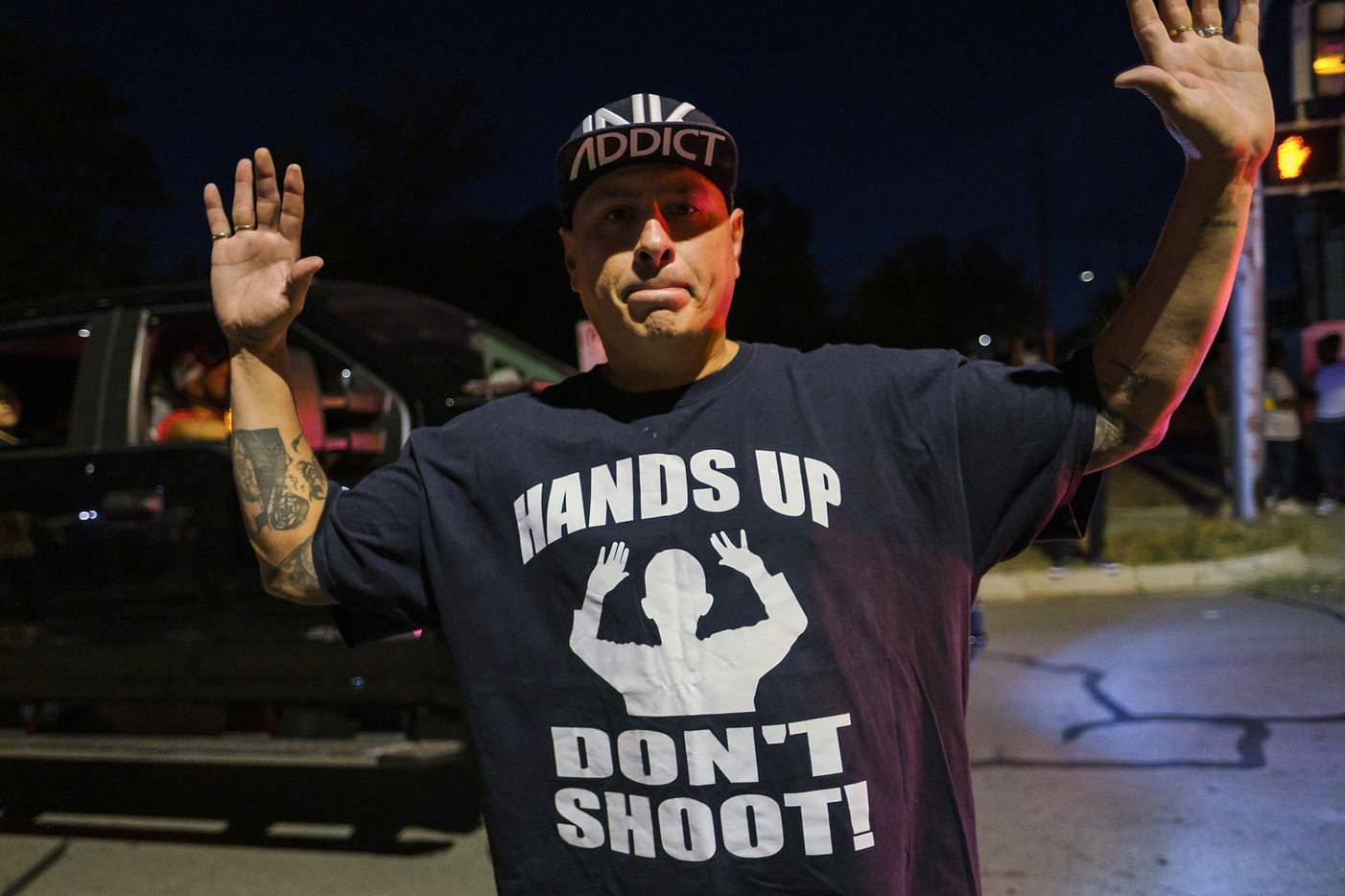 A man wears a shirt reading ÒHands Up DonÕt ShootÓ during a community vigil for Atatiana Jefferson  on Sunday, Oct. 13, 2019, in Fort Worth.